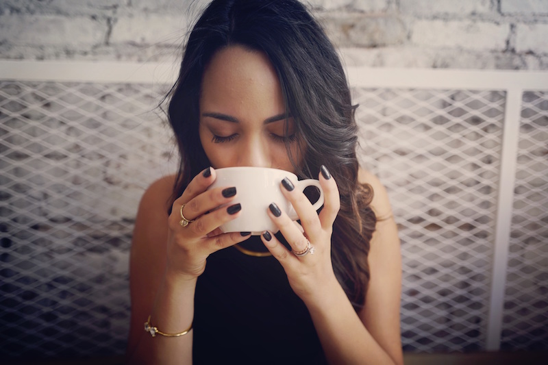 struggling-with-work-overwhelm-woman-drinking-coffee
